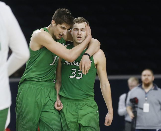 Marshall forward Ajdin Penava (11) hugs Marshall guard Jon Elmore (33) after Elmore make a three point basket against Western Kentucky during the second half of the Conference USA Men's Basketball Championship Game in Frisco, Texas, Saturday, March 10, 2018. Marshall defeated Western Kentucky 67-66. (AP Photo/Michael Ainsworth)