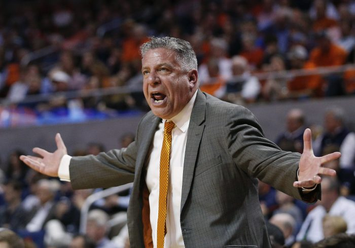 FILE - In this March 3, 2018, file photo, Auburn head coach Bruce Pearl reacts on the sidelines during the first half of an NCAA college basketball game against South Carolina, in Auburn, Ala. Pearl, a coach with an out-sized personality and checkered past, has led Auburn to its first NCAA Tournament in 15 years and a surprising SEC title but still faces questions about his job security amid an internal review of the program. (AP Photo/Brynn Anderson, File)