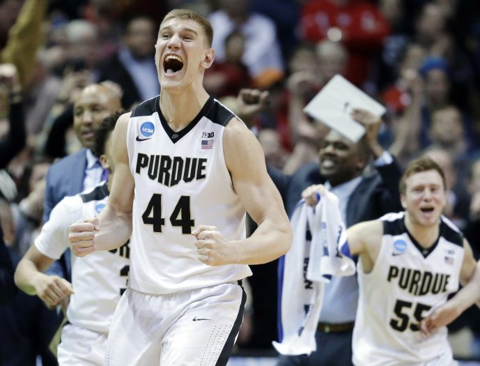 FILE- In this Saturday, March 18, 2017, file photo, Purdue's Isaac Haas (44) and the bench celebrate after defeating Iowa State 80-76 on a second-round game in the NCAA college basketball tournament in Milwaukee. With the one-and-done parade holding steady, salacious scandals tainting some of the country's powerhouse schools and an ongoing FBI investigation that threatens to overshadow the sport's marquee event, the Boilermakers (28-6) are a refreshing throwback to a simpler time. (AP Photo/Kiichiro Sato, File)