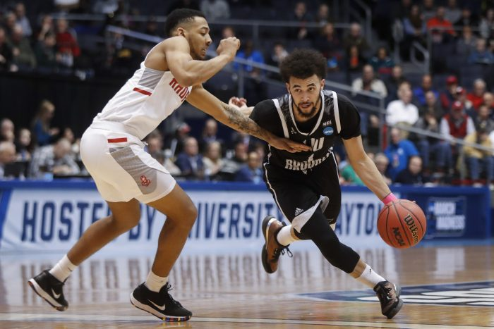 LIU Brooklyn's Julian Batts, right, drives against Radford's Carlik Jones during the first half of a First Four game of the NCAA men's college basketball tournament, Tuesday, March 13, 2018, in Dayton, Ohio. (AP Photo/John Minchillo)