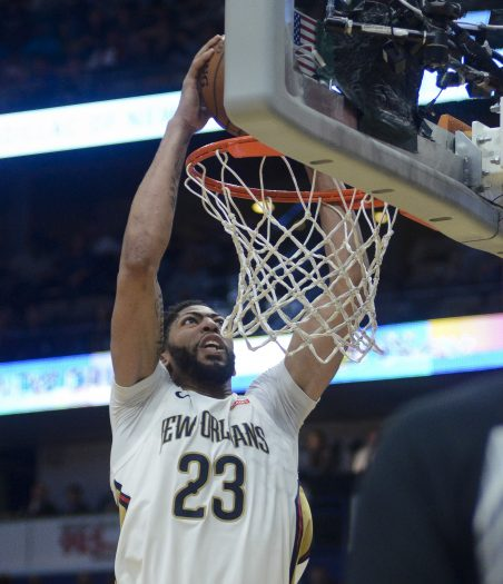 New Orleans Pelicans forward Anthony Davis (23) dunks the ball in the second half of an NBA basketball game against the Charlotte Hornets in New Orleans on Tuesday, March. 13, 2018. New Orleans won 119-115. (AP Photo/Veronica Dominach)