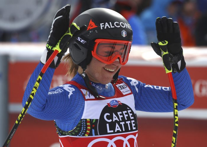 Italy's Sofia Goggia gets to the finish area after completing a women's downhill, at the alpine ski World Cup finals in Are, Sweden, Wednesday, March 14, 2018. (AP Photo/Marco Trovati)