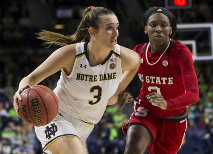 In this Feb. 25, 2018, photo, Notre Dame's Marina Mabrey (3) drives in next to North Carolina State's KaiCrutchfield (3) during the first half of an NCAA college basketball game in South Bend, Ind. When the season became a numbers game for Notre Dame, coach Muffet McGraw decided to make a two into a one. Mabrey, the 5-foot-11 junior shooting guard, was a little apprehensive taking over at point guard. But McGraw, Mabrey and Notre Dame really had no choice after losing two point guards and two other players over nine months to knee injuries that required season-ending surgeries. (AP Photo/Robert Franklin)