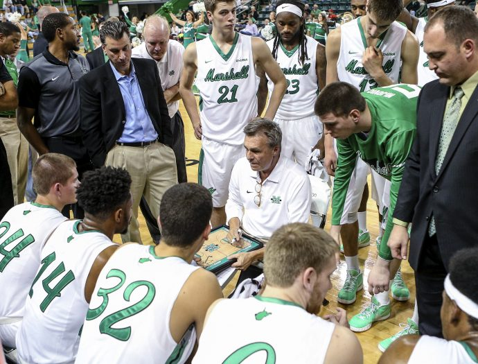 FILE - In this Nov. 12, 2015, file photo, Marshall coach Dan D'Antoni, center, draws up a play during a timeout in an NCAA college basketball exhibition game against Bluefield State in Huntington, W. Va. D'Antoni was a 23-year-old assistant with the Marshall basketball program in 1970, when a plane carrying members of the Wichita State football team crashed in Colorado. Six weeks later, on Nov. 14, 1970, a plane carrying members of the Marshall football team crashed. As fate would have it, Marshall's first trip to the NCAA Tournament in 31 years means a date with Wichita State on Friday, March 16, 2018, in San Diego. (Sholten Singer/The Herald-Dispatch via AP, File)