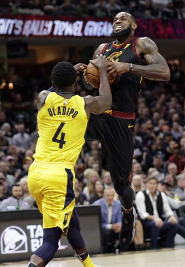 Cleveland Cavaliers' LeBron James (23) drives to the basket against Indiana Pacers' Victor Oladipo (4) in the first half of a first-round playoff series in an NBA basketball game, Sunday, April 15, 2018, in Cleveland. (AP Photo/Tony Dejak)