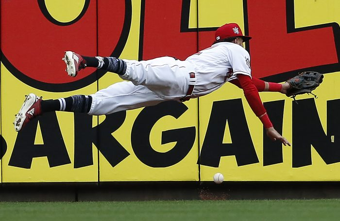 Cincinnati Reds center fielder Billy Hamilton dives for but cannot get to a double off the bat of St. Louis Cardinals' Jose Martinez during the seventh inning of a baseball game, Sunday, April 15, 2018, in Cincinnati. (AP Photo/Gary Landers)