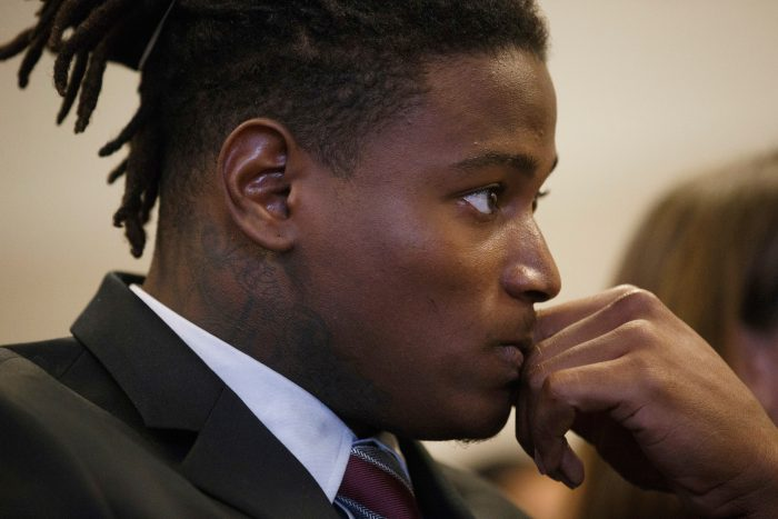 """FILE -In this April 12, 2018 photo, San Francisco 49ers linebacker Reuben Foster appears for his arraignment at the Santa Clara County Hall of Justice in San Jose, Calif. Foster won't participate in the offseason program while he tends to legal matters related to his domestic violence charges. The 49ers said in a statement Sunday, April 15, 2018 that his future with the team will be """"determined by the information revealed during the legal process."""" (Dai Sugano/San Jose Mercury News via AP, Pool)"""