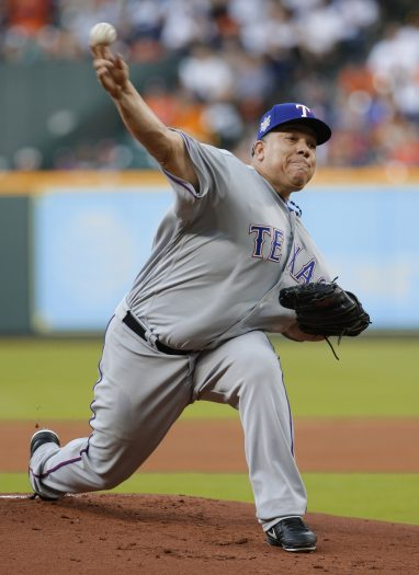 Texas Rangers' starting pitcher Bartolo Colon throws against the Houston Astros during the first inning of a baseball game Sunday, April 15, 2018, in Houston. (AP Photo/Michael Wyke)