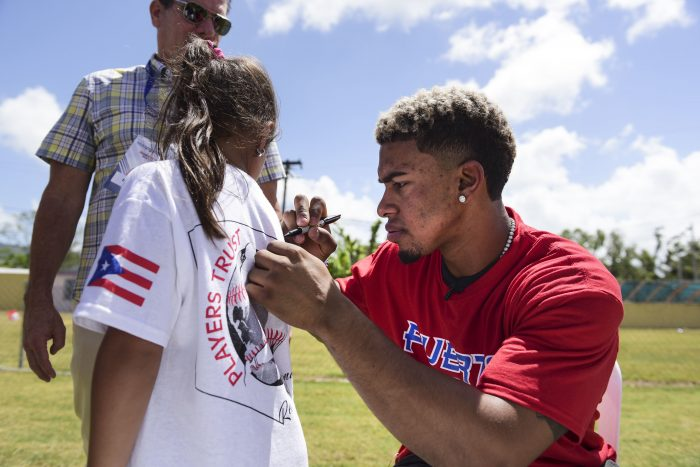 Cleveland Indians All-Star shortstop Francisco Lindor visits his former grammar school, Villa Marina Elementary School, to lead a special baseball clinic for approximately 250 students in Gurabo, Puerto Rico, Monday, April 16, 2018. Next Tuesday and Wednesday, the Cleveland Indians and the Minnesota Twins will meet in a two-game series at Hiram Bithorn Stadium in San Juan. (AP Photo/Carlos Giusti)