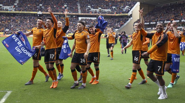 Wolverhampton Wanderers players celebrate winning their promotion to the English Premier League after the Championship soccer match against Birmingham City at Molineux, Wolverhampton, England, Sunday April 15, 2018. (Nigel French/PA via AP)