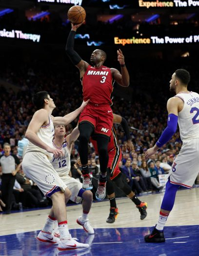 Miami Heat's Dwyane Wade, right, shoots with Philadelphia 76ers' T.J. McConnell, center, and Ersan Ilyasova, left, of Turkey, defend during the first half in Game 2 of a first-round NBA basketball playoff series, Monday, April 16, 2018, in Philadelphia. (AP Photo/Chris Szagola)