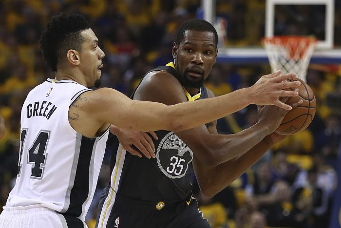 Golden State Warriors' Kevin Durant (35) is guarded by San Antonio Spurs' Danny Green (14) during the first quarter in Game 2 of a first-round NBA basketball playoff series Monday, April 16, 2018, in Oakland, Calif. (AP Photo/Ben Margot)