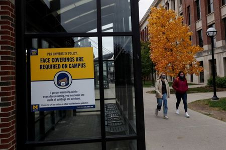 As COVID-19 cases soar, U.S. families weigh risks of welcoming college kids home